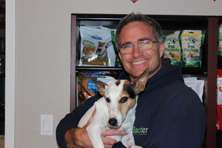Dr. Tim Blatt Veterinarian at Baxter Animal Hospital with dog